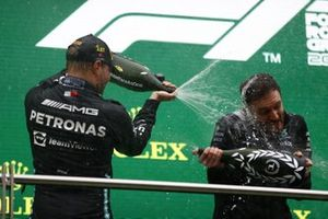 Valtteri Bottas, Mercedes, 1st position, sprays Champagne with his team mate on the podium