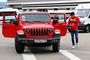 Carlos Sainz Jr., Ferrari, arrives at the circuit in a Jeep