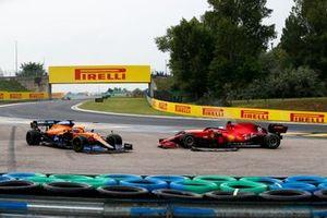 Daniel Ricciardo, McLaren MCL35M, and Charles Leclerc, Ferrari SF21, off the circuit after a crash on the opening lap
