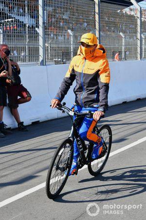 Lando Norris, McLaren, on a bike
