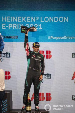 Mitch Evans, Jaguar Racing, 3rd position, lifts his trophy