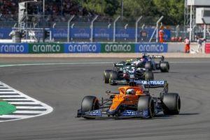 Daniel Ricciardo, McLaren MCL35M, Sebastian Vettel, Aston Martin AMR21, and George Russell, Williams FW43B