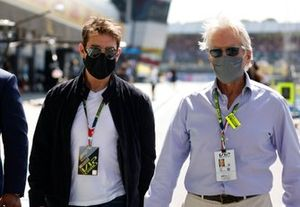 Actors Tom Cruise and Michael Douglas on the grid