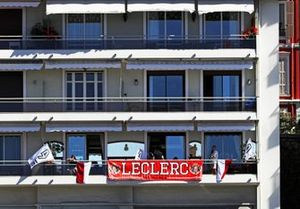 Support for Charles Leclerc, Ferrari, on a balcony