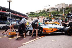 Daniel Ricciardo, McLaren MCL35M, is returned to the garage