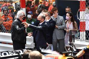 Flavio Briatore and Stefano Domenicali, CEO, Formula 1, on the grid