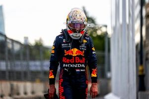 Max Verstappen, Red Bull Racing, walks back to the garage after crashing out from the lead