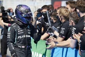 Lewis Hamilton, Mercedes, celebrates with his team in Parc Ferme after securing his 100th pole position F1