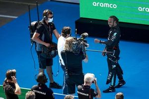 Lewis Hamilton, Mercedes is interviewed by Paul de la Rosa after securing his 100th pole in F1