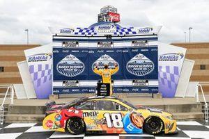 Kyle Busch, Joe Gibbs Racing, Toyota Camry M&M's Mix, celebrates after winning in Kansas.