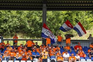 Fans of Max Verstappen, Red Bull Racing, fly the Dutch colours in the grandstand