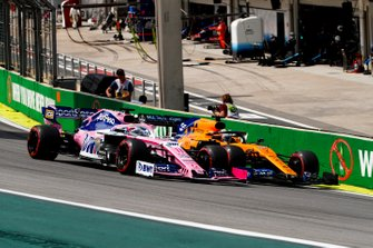 Sergio Perez, Racing Point RP19 and Carlos Sainz Jr., McLaren MCL34 battle
