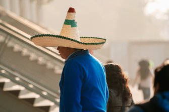 A fan wearing a traditional Mexican hat