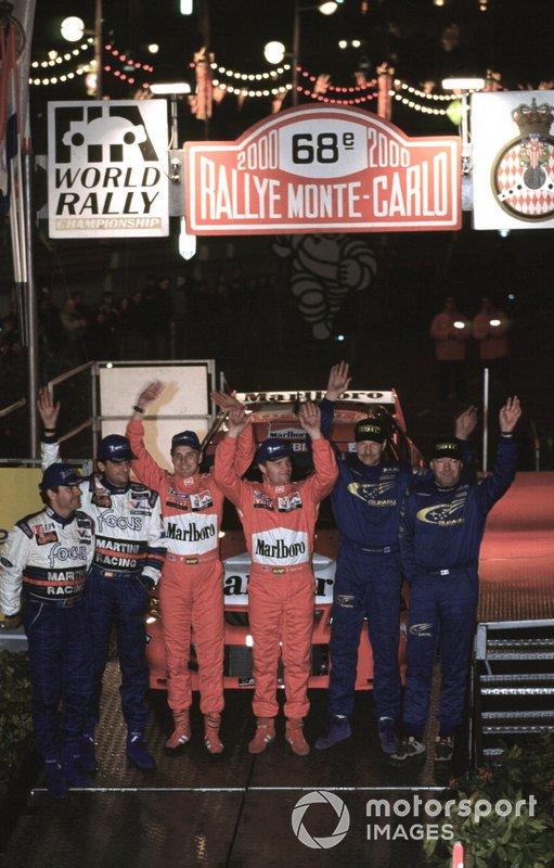 Tommi Makinen celebrates victory, second place Carlos Sainz, third place Juna Kankunnen