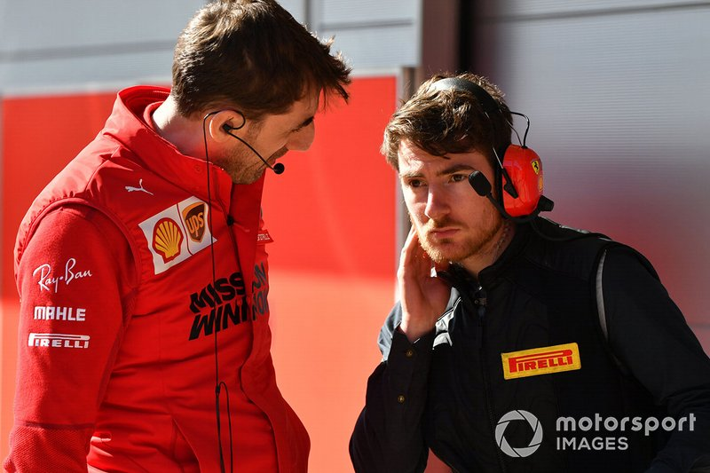 A Ferrari and Pirelli engineer in discussion