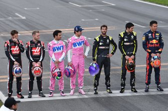 Romain Grosjean, Haas F1, Kevin Magnussen, Haas F1, Sergio Perez, Racing Point, Lance Stroll, Racing Point, Daniel Ricciardo, Renault F1, Esteban Ocon, Renault F1 and Alexander Albon, Red Bull Racing line up on the track