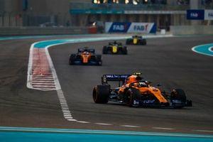 Lando Norris, McLaren MCL34, leads Carlos Sainz Jr., McLaren MCL34, Daniel Ricciardo, Renault F1 Team R.S.19, and Nico Hulkenberg, Renault F1 Team R.S. 19