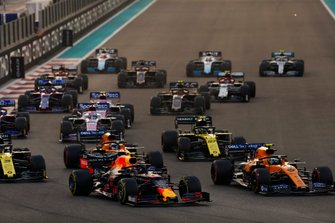Alexander Albon, Red Bull RB15, leads Lando Norris, McLaren MCL34, Carlos Sainz Jr., McLaren MCL34, Daniel Ricciardo, Renault F1 Team R.S.19 and the rest of the pack