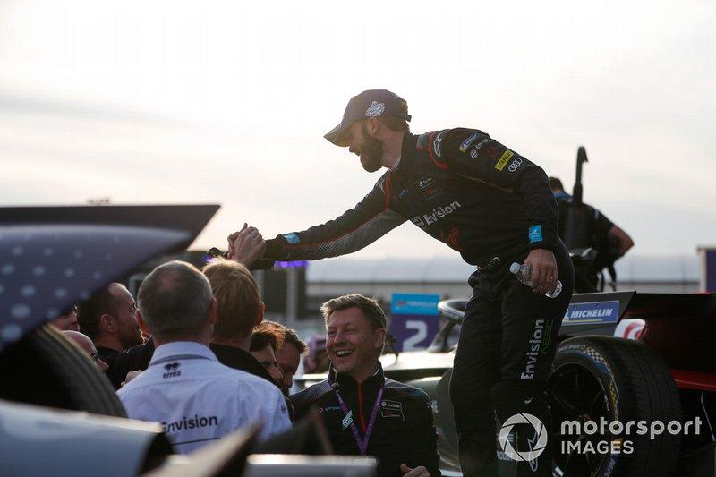 Race winner Sam Bird, Virgin Racing celebrates with his team on the podium
