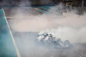 Lewis Hamilton, Mercedes AMG F1 W10, 1st position, and Max Verstappen, Red Bull Racing RB15, 2nd position, perform donuts