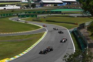 Romain Grosjean, Haas F1 Team VF-19, leads Kimi Raikkonen, Alfa Romeo Racing C38, Kevin Magnussen, Haas F1 Team VF-19, and Antonio Giovinazzi, Alfa Romeo Racing C38