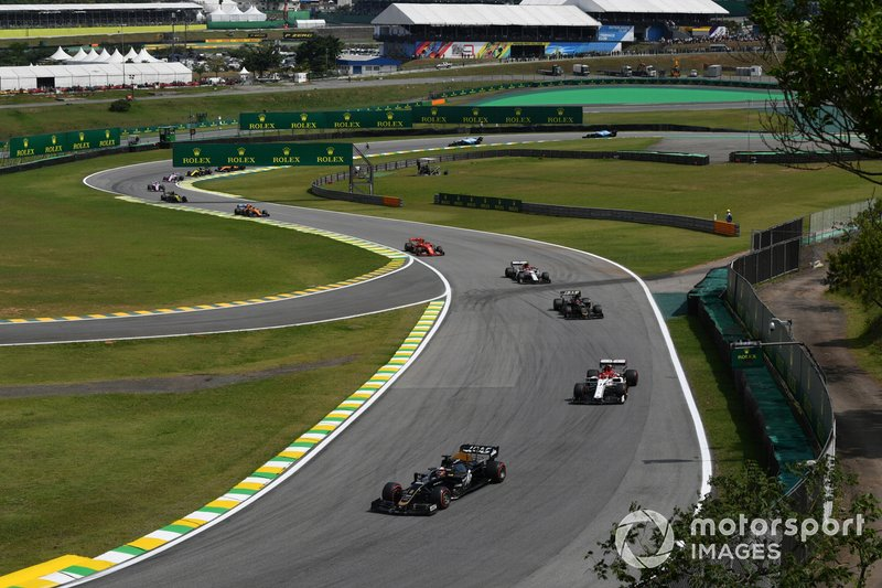 Romain Grosjean, Haas F1 Team VF-19, leads Kimi Raikkonen, Alfa Romeo Racing C38, Kevin Magnussen, Haas F1 Team VF-19, and Antonio Giovinazzi, Alfa Romeo Racing C38