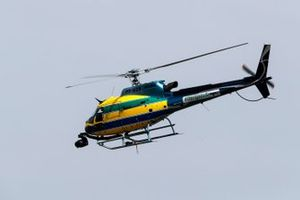 A helicopter in the colours of the helmet worn by Ayrton Senna