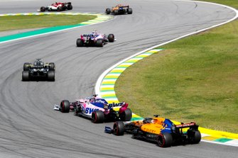 Lance Stroll, Racing Point RP19, leads Daniel Ricciardo, Renault F1 Team R.S.19, Sergio Perez, Racing Point RP19, and Carlos Sainz Jr., McLaren MCL34