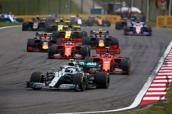 Valtteri Bottas, Mercedes AMG W10, leads Charles Leclerc, Ferrari SF90, Sebastian Vettel, Ferrari SF90, Max Verstappen, Red Bull Racing RB15, and Pierre Gasly, Red Bull Racing RB15