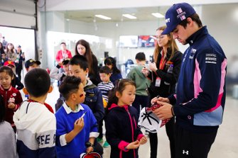 Lance Stroll, Racing Point signs an autograph for grid kids