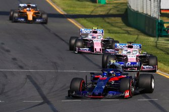 Alexander Albon, Toro Rosso STR14, leads Sergio Perez, Racing Point RP19, and Lance Stroll, Racing Point RP19
