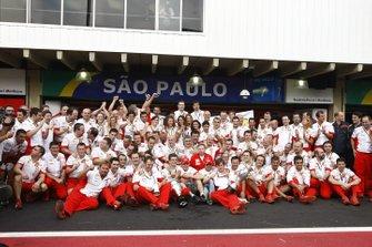 The Ferrari team celebrate victory