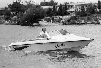 Denny Hulme, on his boat