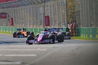 Sergio Perez, Racing Point RP19, leads Lance Stroll, Racing Point RP19, and Carlos Sainz Jr., McLaren MCL34