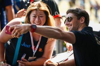 Romain Grosjean, Haas F1 Team, takes a selfie with a fan