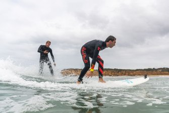 Three-time surfing world champion Mick Fanning takes Pierre Gasly surfing in Torquay