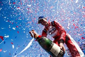 Pascal Wehrlein, Mahindra Racing, celebrates his maiden podium finish on the podium