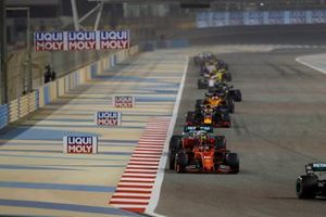 Charles Leclerc, Ferrari SF90, leads Lewis Hamilton, Mercedes AMG F1 W10, and Max Verstappen, Red Bull Racing RB15