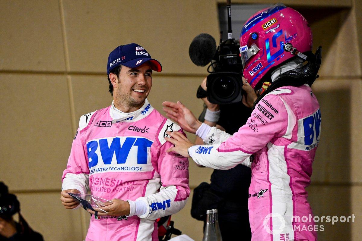 Sergio Pérez, Racing Point, 1ª posición, y Lance Stroll, Racing Point, 3ª posición, celebran en Parc Ferme