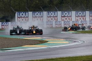 Lewis Hamilton, Mercedes W12, and Max Verstappen, Red Bull Racing RB16B, make contact on the opening lap