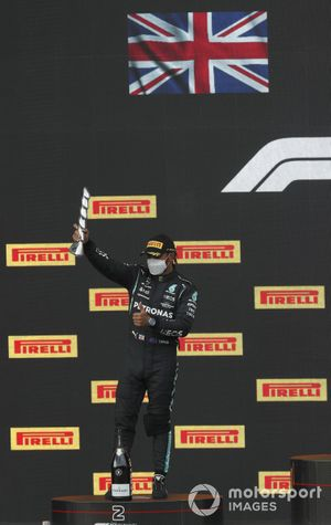 Lewis Hamilton, Mercedes, 2nd position, with his trophy