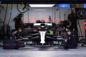 Mechanics work on the car of Lewis Hamilton, Mercedes F1 W11