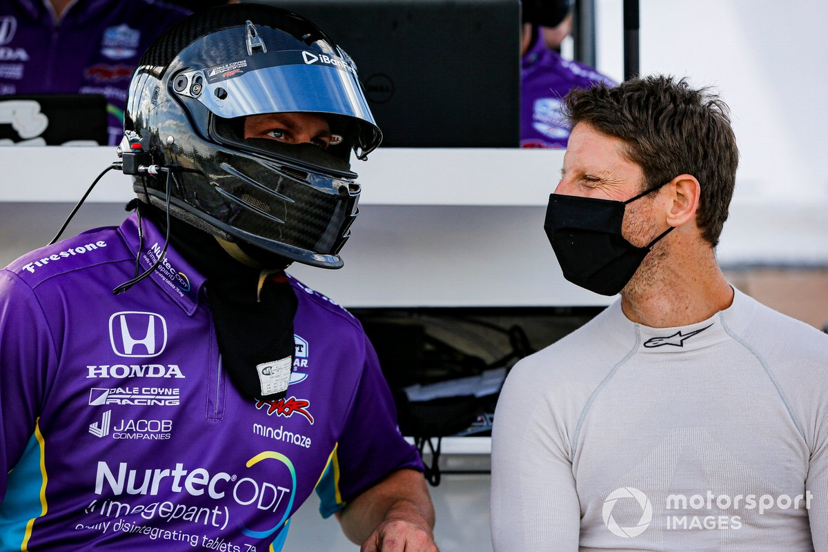 Romain Grosjean, Dale Coyne Racing with Rick Ware Racing Honda con un miembro de su equipo