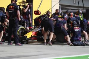 Sergio Perez, Red Bull Racing RB16B, in the pits during FP1