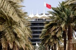 The Bahraini flag flies over a building at the circuit