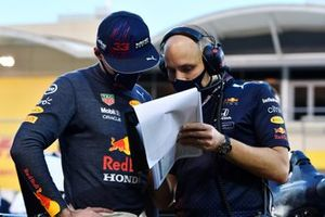 Max Verstappen, Red Bull Racing, with an engineer on the grid