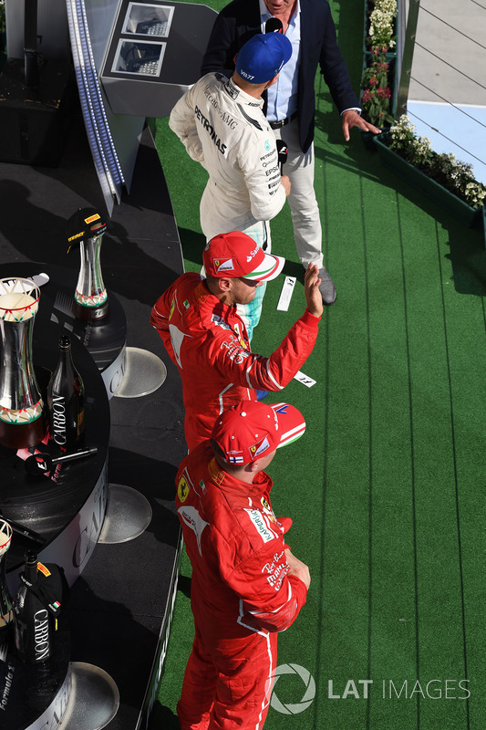 Подіум: переможець Себастьян Феттель, Ferrari, Кімі Райкконен, Ferrari, Валттері Боттас, Mercedes AMG F1