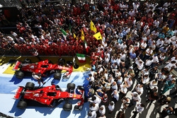 The Sebastian Vetteleads and Kimi Raikkonen, Ferrari SF70H cars in parc ferme