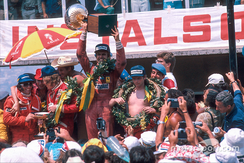 Race winner Carlos Reutemann, Ferrari, second place James Hunt, McLaren Ford and third place Niki La
