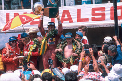 Race winner Carlos Reutemann, Ferrari, second place James Hunt, McLaren Ford and third place Niki Lauda, Ferrarion the podium with Emerson Fittipaldi